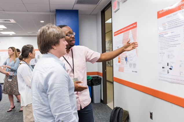 William is pictured during a Draper Lab Fellow poster session, presenting his research on intra-body communication potential applications